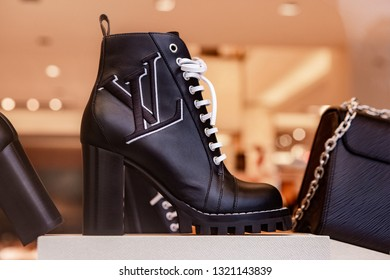 Moscow, Russia - February, 2019: Black High Leather Boot From New Louis Vuitton Collection With VL Logo. Luxury Store Louis Vuitton In Moscow.