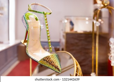 Moscow, Russia - February 2019: Women's Shoe Made Of Green Iridescent Leather With Spikes On High Heel Of New Collection Of Louboutin. Luxury Store Louboutin In Moscow.