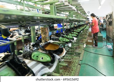 MOSCOW, RUSSIA - FEBRUARY 21, 2017: Moscow shoe factory JSC RALF RINGER. Shoes on the conveyor of the shoe factory.