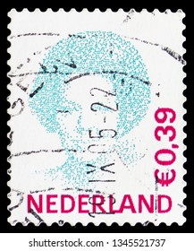 "MOSCOW, RUSSIA - FEBRUARY 21, 2019: A stamp printed in Netherlands shows Queen Beatrix (1938-), Queen Beatrix type ""Inversion"" serie, circa 2002"