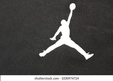 MOSCOW, RUSSIA - FEBRUARY 22, 2018: Air Jordan Brand White Logo Printed on Black Sweatshirt Background. Air Jordan is a Nike Sportswear Company Brand of Basketball Footwear and Sporting Clothes.