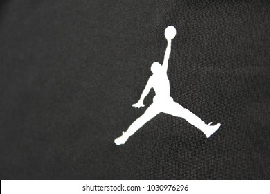 MOSCOW, RUSSIA - FEBRUARY 22, 2018: Air Jordan Brand Logo Print on Black Shirt Background. Air Jordan is a Nike Company Brand of Basketball Footwear and Athletic Clothing, Created for Michael Jordan.