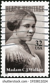 MOSCOW, RUSSIA - FEBRUARY 23, 2021: A stamp printed in USA shows Madam C J Charles Joseph Walker Sarah Breedlove (1867-1919), entrepreneur, Self Adhesive, Black Heritage Series, 2000
