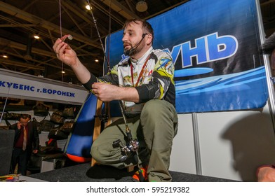 Moscow, Russia - February 25, 2017: Professional fisherman promote wobblers and tackles on the special fishing show