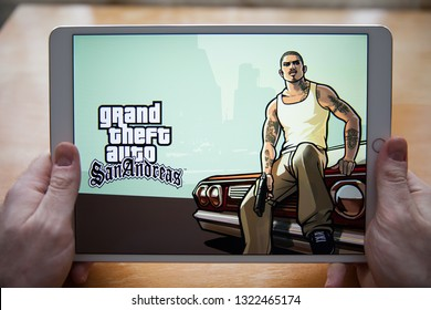 Moscow / Russia - February 25, 2019: White ipad in hand. On the screen, the game Grand Theft Auto