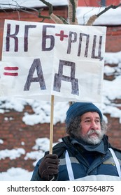 Moscow - Russia, February 25th 2018, memorial march of Boris Nemtsov.Bearded man holding streamer, which says - KGB plus RPC (Russian Orthodox Church) is hell
