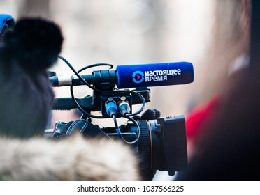 Moscow - Russia, February 25th 2018: camera with microphone of a russian tv company Nastoyaschye vremya (eng. Real time) on a march of Boris Nemtsov