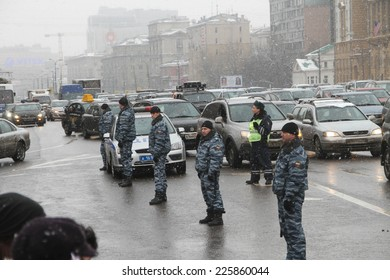 Moscow, Russia - February 26, 2012. Police watching the opposition during the campaign White ring. Muscovites lined up in the ring for the Garden ring in Moscow during the campaign the White ring
