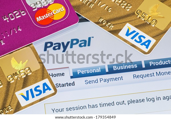 Moscow, Russia - February 27, 2014: Online shopping paid via Paypal payments using plastic cards Visa and Mastercard. PayPal is a popular and international method of money transfer via the Internet.