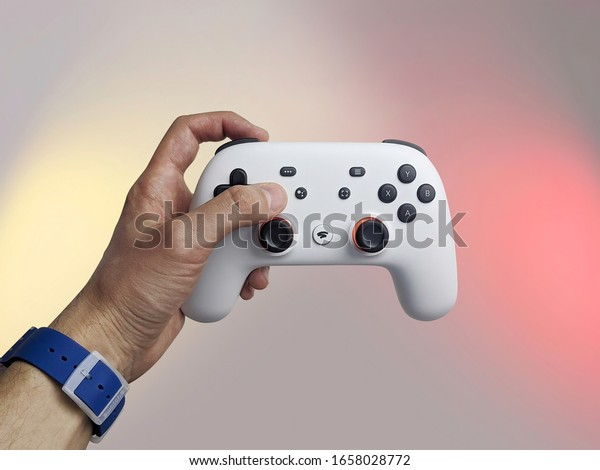 Moscow / Russia - February 27, 2020: Man hand holding Google Stadia controller
