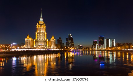 Moscow, Russia - February 5, 2017:Hotel Radisson Royal, the Moscow International Business Center and Moscow World Trade Center-symbols of Stalin, Brezhnev and Putin eras. Reflections in river, evening