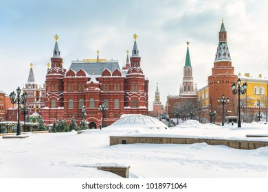 Moscow, Russia - February 5, 2018: Manezhnaya Square, the State Historical Museum and Moscow Kremlin in winter. View of central Moscow during snowfall. Historical architecture and landmark of Moscow.