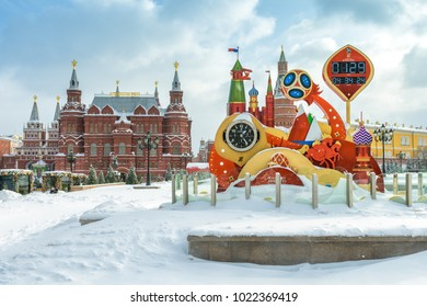 Moscow, Russia - February 5, 2018: FIFA World Cup 2018 countdown clock at the heart of Moscow in winter. Manezhnaya Square during snowfall. State Historical Museum and Moscow Kremlin in background.
