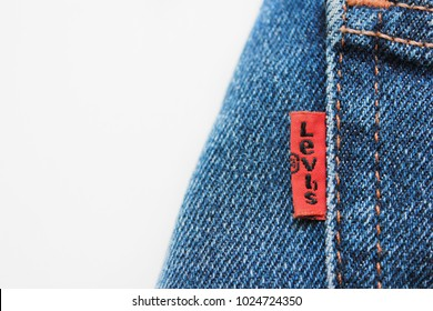 MOSCOW, RUSSIA - FEBRUARY 9, 2018: Levi's Blue Denim Jeans with Red Brand Label on Back Side Pocket. Close Up of Isolated Denim Bottom Pants of Levi Strauss & Co, Known for Levi's Denim Jeans Brand.