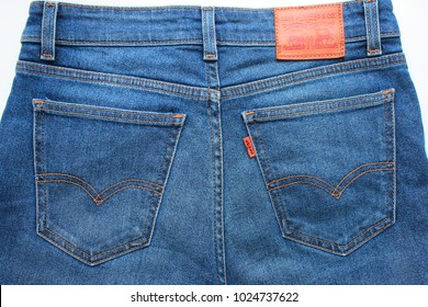 MOSCOW, RUSSIA - FEBRUARY 9, 2018: Levi's Blue Denim Jeans Back Side Pockets. Levis Modern Urban Lifestyle Denim Clothing Apparel with Leather and Red Label Top View. Levi Strauss Jeans Top View Photo