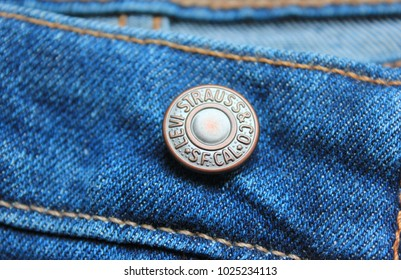 MOSCOW, RUSSIA - FEBRUARY 9, 2018: Levi's Denim Jeans Metal Button Close Up. Detail of Vintage Style Classic Blue Levi Strauss Jeans. Detail of Casual Bottom Levi Strauss & Co Jeans Pants.