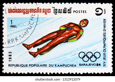 MOSCOW, RUSSIA - FEBRUARY 9, 2019: A stamp printed in Kampuchea (Cambodia) shows Olympics Sarajevo '84, Luge, Winter Olympic Games 1984, Yugoslavia serie, circa 1983