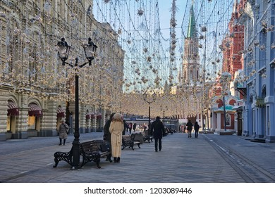 MOSCOW, RUSSIA - Festive and Bright Nikolskaya Street. Walking under festive garlands at the pedestrian Nikolskaya street on the way to the Red Square.