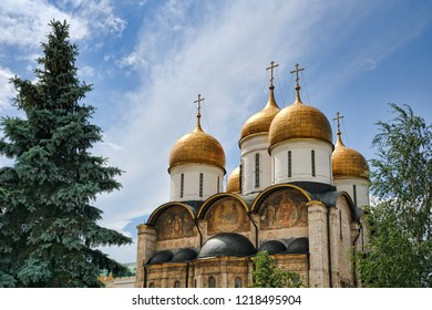 MOSCOW, RUSSIA - Golden Domes of Assumption Cathedral in Moscow Kremlin. View from East side on the top of magnificent Cathedral in background of blue sky in summer.