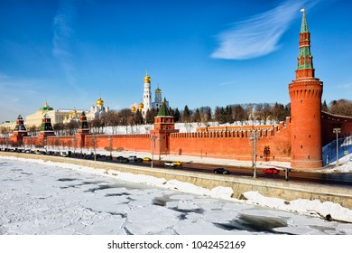 Moscow. Russia. The Grand Kremlin Palace on the banks of the Moscow river. Kremlin embankment runs along the Moscow river past the southern wall of the Kremlin with seven towers.