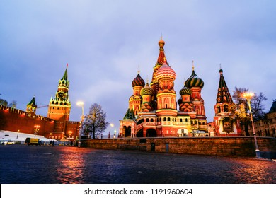 Moscow, Russia. Illuminated Saint Basil Cathedral on Red Square at night with Kremlin wall and Tower. One of the most popular landmark in Russia. Cloudy sky in winter