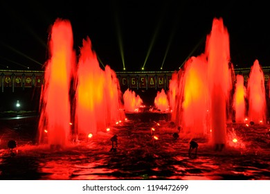 MOSCOW, RUSSIA - Impressive fountains on Square of Victors spotted with red lights and testing video mapping projections on the facade of Victory Museum on Poklonnaya Hill for Circle of Light festival