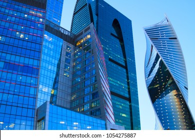 """Moscow, Russia. International Business Center (Moscow-City).   """"City of Capitals"""", Business complex """"Empire"""", Evolution Tower. Sunset lighting of skyscrapers."""