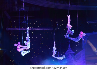 """MOSCOW, RUSSIA - JAN 06, 2013: Children's new year performance """"Circus Santa Claus II - Olympic New Year"""" in Olympic Stadium (sport complex). The performance of the trapeze artists"""