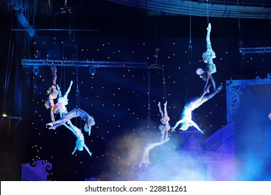 "MOSCOW, RUSSIA - JAN 06, 2013: Children's new year performance ""Circus Santa Claus II - Olympic New Year"" in Olympic Stadium (sport complex). The performance of the trapeze artists"