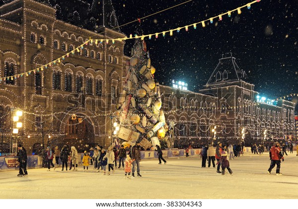 MOSCOW, RUSSIA - JAN 07, 2016: Visitors to skate at the GUM Skating-rink on the Red Square in Moscow