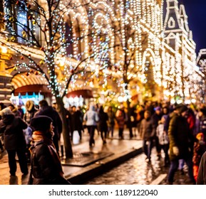 MOSCOW, RUSSIA - JAN 1: Picture blurred for background abstract. People on Christmas eve and New year's walk around city and go to shopping house GUM near Red Square on Jan 1, 2017 in Moscow, Russia