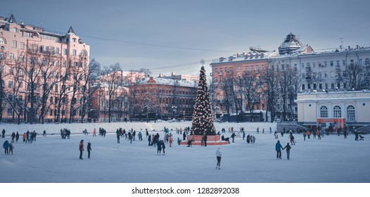 Moscow, Russia - Jan 2019: Ice-skating people with Christmas tree in Patriarch Ponds at centre of Moscow Common on January.