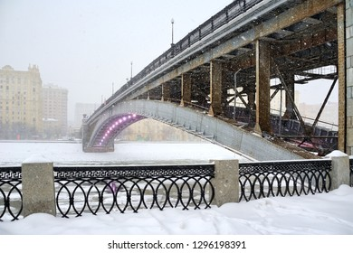 MOSCOW, RUSSIA - Jan 26, 2019 Angle view at the steel arch Smolensky Metro Bridge that spans Moskva River in Dorogomilovo District of Moscow during the massive snowfall in afternoon.