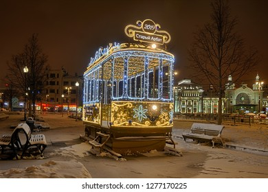 "MOSCOW, RUSSIA - January 04, 2019: Illuminated new year tram with signs ""2019"" and ""Old Arbat"" (Stary Arbat) decorates Tverskaya Zastava square during winter holidays 2018-2019."