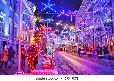 "MOSCOW, RUSSIA - JANUARY 05, 2016: Festival ""Journey to Christmas"" on Bolshaya Dmitrovka street decorated with disco balls and lights sculptures of dancing couple, Moscow, Russia"