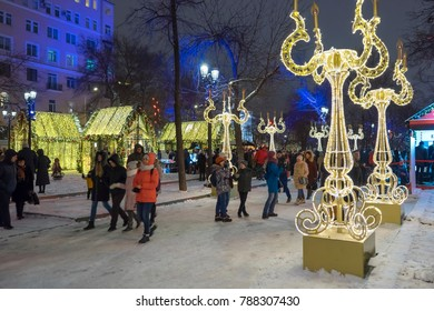 Moscow, Russia - January 05, 2018: Tverskoy blvd. New Year holidays. A lot of people and tourists walk among the holiday lights and illumination