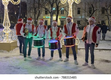 Moscow, Russia - January 05, 2018: Tverskoy blvd. New Year holidays. Group of drummers in costume of Santa Claus play for people
