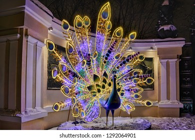 MOSCOW, RUSSIA -  January 05, 2019 Amazing lluminated Peacock at the Entrance to the Moscow Zoo from the Garden Ring (Sadovoye Koltso) during the winter holidays.