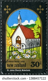 MOSCOW, RUSSIA - JANUARY 05, 2019: A stamp printed in New Zealand shows Saint John the Baptist Church, Wakefield, New Hampshire, Christmas, 1981