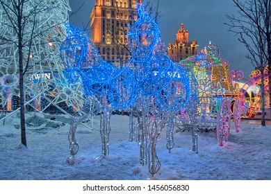 "MOSCOW, RUSSIA - January 06, 2019 Beautiful new year light installation with fairytale horses and carriage at the luxury fish and seafood restaurant ""Erwin"" on Tarasa Shevchenko embankment"