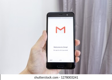 MOSCOW, RUSSIA - JANUARY 08, 2018: Hand holding a smartphone with Google Gmail application icon. Gmail app icon. Gmail is popular Internet online e-mail.