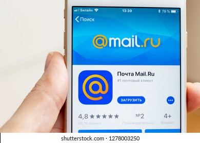 MOSCOW, RUSSIA - JANUARY 08, 2018: Hand holding Apple Iphone 7s with mail.ru application downloading from app store on the screen.