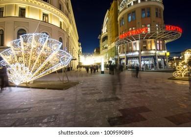 MOSCOW, RUSSIA - JANUARY 09, 2018: Christmas (New Year holidays) illumination on Nikolskaya Street near the Moscow Kremlin at night, Russia