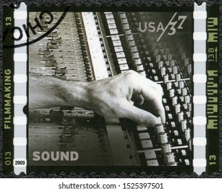 MOSCOW, RUSSIA - JANUARY 09, 2018: A stamp printed in USA shows Sound Gary Summers works on control panel, American Filmmaking Behind the Scenes, 2003