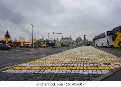 MOSCOW, RUSSIA - January 1, 2010: old paved road on Vasilyevsky Spusk, pedestrian crossing, marking and view of the bridge in the daytime