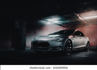 Moscow, Russia - January 10, 2018: Electric car Tesla Model S P85 wrapped in grey color matte vinyl at underground parking