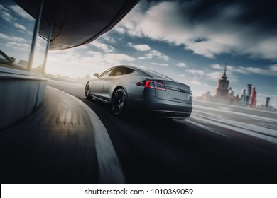Moscow, Russia - January 10, 2018: Electric car Tesla Model S P85 fast speed drive on the road at sunset. Back view
