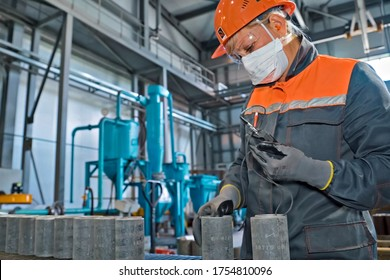 Moscow, Russia - January 10, 2020: A worker measures the thickness of the couplings of pumping oil pipes.