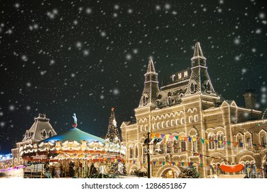 MOSCOW, RUSSIA - JANUARY, 13 2019: Moscow GUM market with snow and christmas lights Night building bright new year selebration decorations