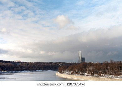 Moscow / Russia - january 15 2018:  Funicular. Skyscraper on background and the cabins of funicular. River in the city with blue sky. Clouds. Copy space and free soace for text